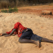One child passed out to the edge of the forest - Tanzania - Afri - Stock Photo