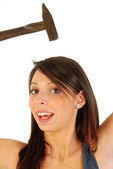 A girl full of irony and armed with a hammer 166 — Stock Photo