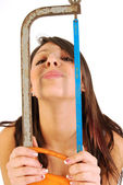 A girl full of irony and armed with saw 176 — Stock Photo