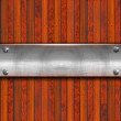 Metal Plate on Wood Background - Stockfoto