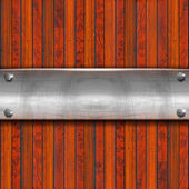 Metal Plate on Wood Background — Stock Photo