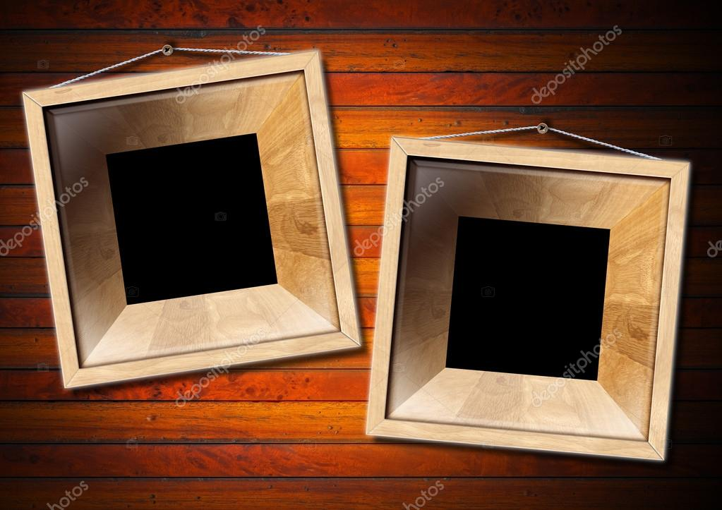 Two empty frames of light wood on a old dark wooden wall  Stock Photo #12518964