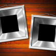 Royalty-Free Stock Photo: Two Metal Frame on a Old Wood Wall