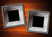 Two Metal Frame on a Old Wood Wall — Stock Photo