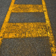 Old Asphalt and Yellow Lines - Stock Photo