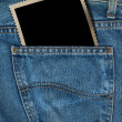Photo in a Pocket of Blue Jeans — Stock Photo
