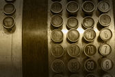Monochromatic Antique Cash Register Buttons — Stock Photo