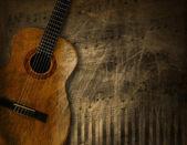 民谣吉他 grunge 背景上 — 图库照片
