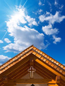 Roof of Wooden Church with Cross — Stok fotoğraf