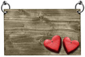 Red Hearts on Wooden Signboard with clipping path — Stock Photo