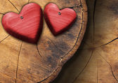 Red Wooden Hearts on Trunk Section — Stock Photo
