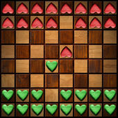 Chess Board with Wooden Hearts — Stock Photo