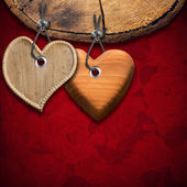 Two Wooden Hearts on Red Floral Background — Stock Photo