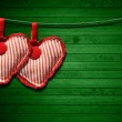 Red Cloth Hearts on Green Wood Background — Stock Photo