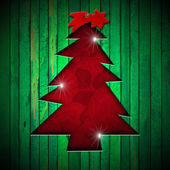 Christmas Tree Shape cut on Green Wall — Stock fotografie
