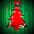 Christmas Tree Shape cut on Green Wall — Stock Photo