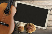 Guitar and Photo Frame on Wood Boardwalk — Stockfoto