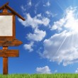 Double Directional Wooden Signs on Blue Sky — Stock Photo