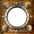 Metal Porthole with Seashells — Stock Photo