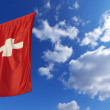 Switzerland Flag in Blue Sky — Stock Photo #45984787