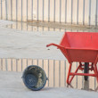 Stock Photo: Concrete wheel barrow with Can