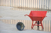 Concrete wheel barrow with Can — Stock Photo