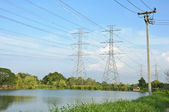 High voltage tower side of the pond — Stock Photo