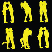 Couple kissing yellow silhouette — Stock Vector