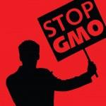 Постер, плакат: Man with the slogan stop gmo
