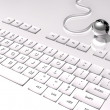 Stock Photo: 3D Keyboard on white background and connection with the world, silver globe