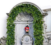 Manneken Pis is a statue in Brussels. A tourist attraction. — Stock Photo