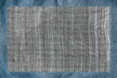 Cloth attached by threads to jeans — Stock fotografie