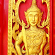 Native Thai style carving, painting on church door in the temple — Stock Photo #13639495