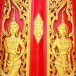 Native Thai style carving, painting on church door in the temple — Stock Photo #13639552