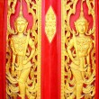 Native Thai style carving, painting on church door in the temple — Stock Photo #13639621