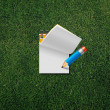 Paper note with pencil — Stockfoto