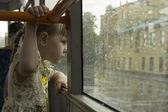 Little girl looking throw tram window — Stock Photo