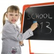 Little girl teaching near board in studio - Stock Photo