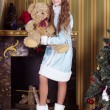 Stock Photo: Snow-maiden holding teddy bear