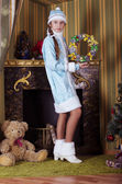 Snow-maiden decorate fireplace — Stock Photo