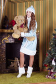Snow-maiden holding teddy bear — Stock Photo