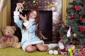 Snow-maiden looking at bird decoration — Stock Photo