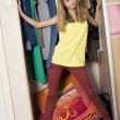Teenage girl in wardrobe at home — Stock Photo #18504669