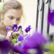 Young girl sniffing beautifull flowers — Stock Photo