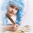 Little girl with blue hair writing a book — Stock Photo #18506313