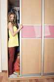 Teenage girl in wardrobe at home — Stock Photo