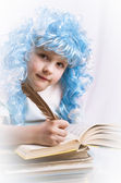 Little girl with blue hair writing a book — Stock Photo