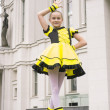 Little girl dancing in bee costume — Stock Photo