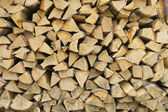 Wooden firewood stack background — Stock Photo