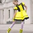 Little girl dancing in bee costume — Stock Photo #28510939